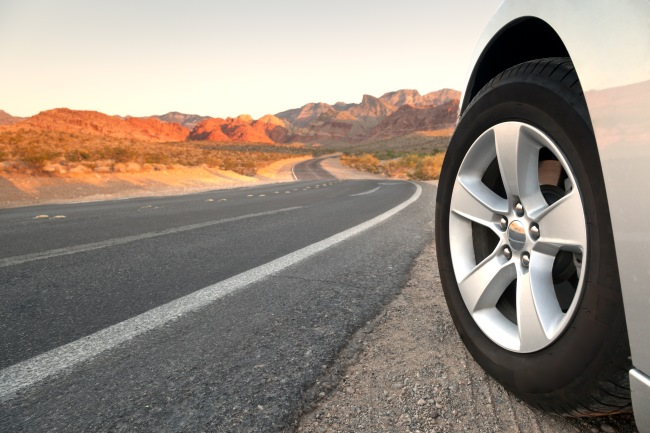 When the rubber hits the road, car wheel on side road.